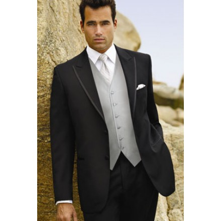 830e3fdaa69 Black tuxedo jacket with 2-buttons and peak lapels.