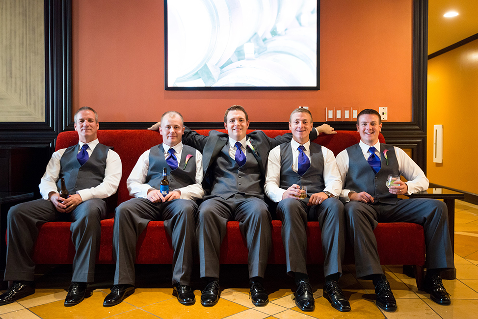Groom and his men pose together on a couch